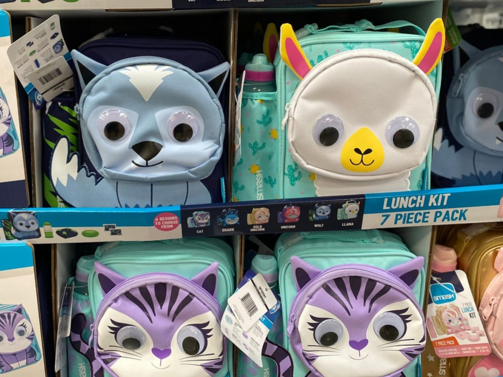 store display with lunch boxes that have animals on it