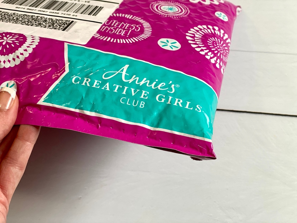 holding Annie's Creative Girls club package