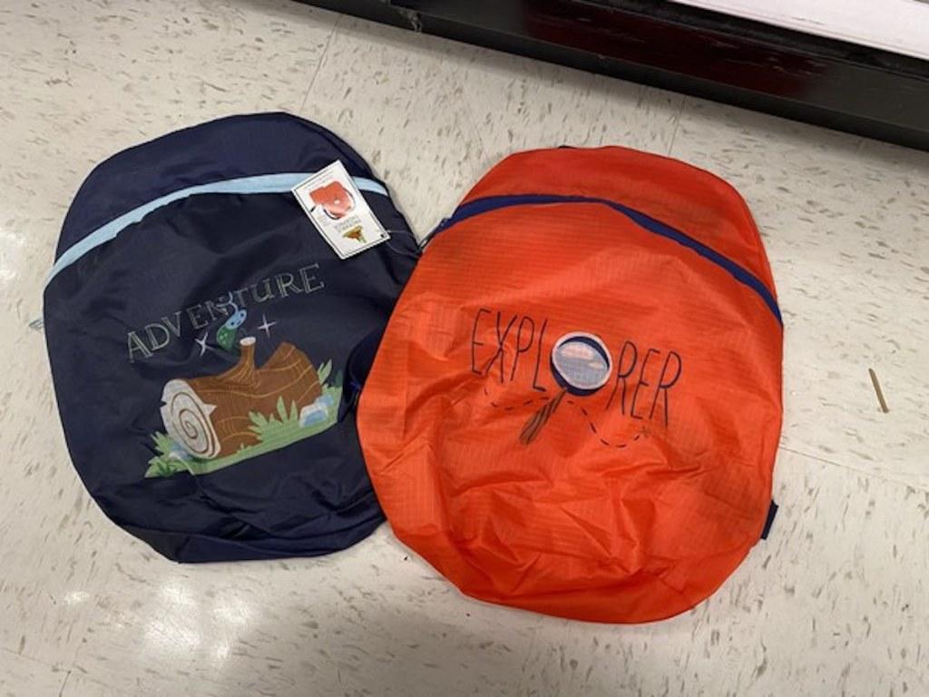dark blue adventure backpack and red explorer backpack from the Target Bullseye