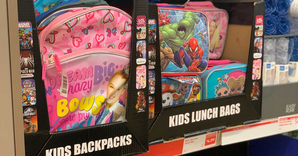 colorful character backpacks and lunch bags on a store shelf
