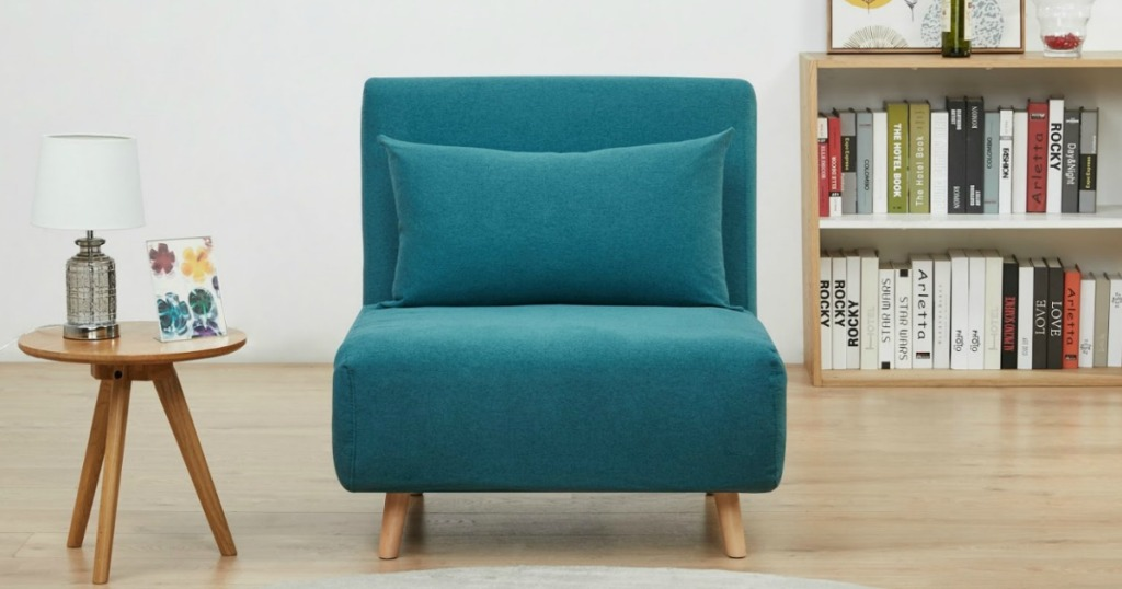 blue convertible chair next to side table
