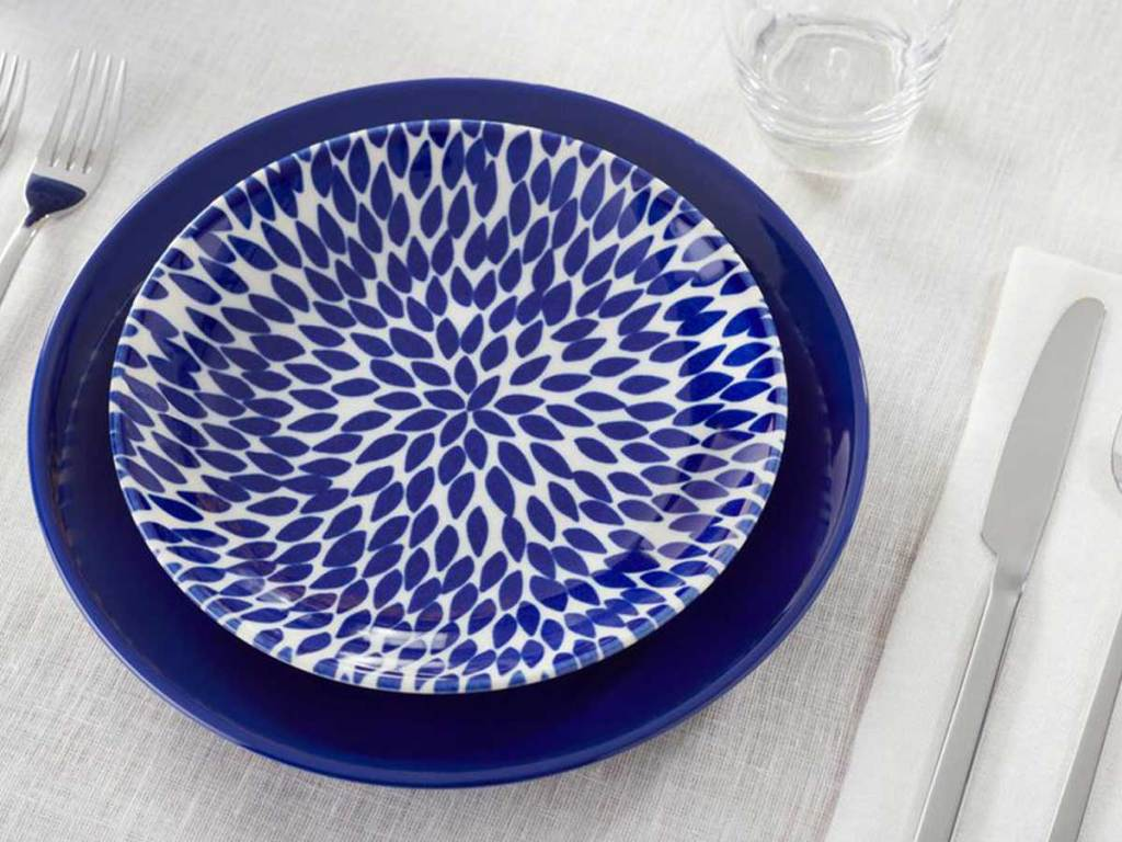 blue dinnerware setting on a table