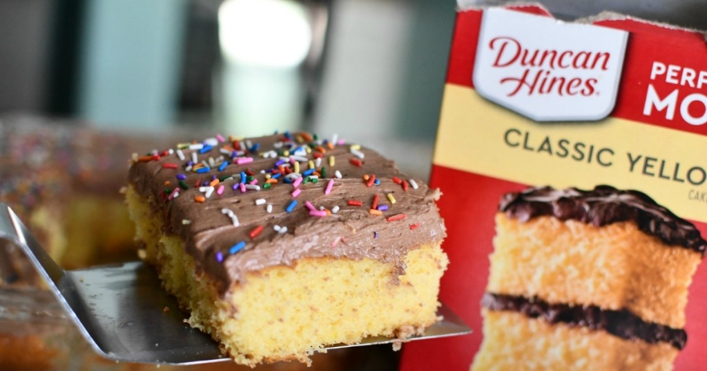 slice of yellow cake with chocolate frosting and duncan hines box