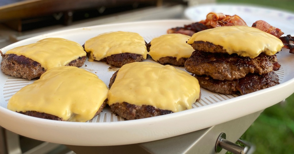 grilled cheeseburgers on a platter