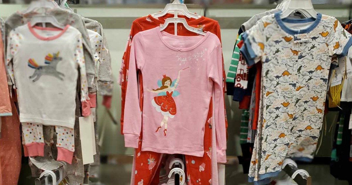 sets of kids pajamas on a store wall display