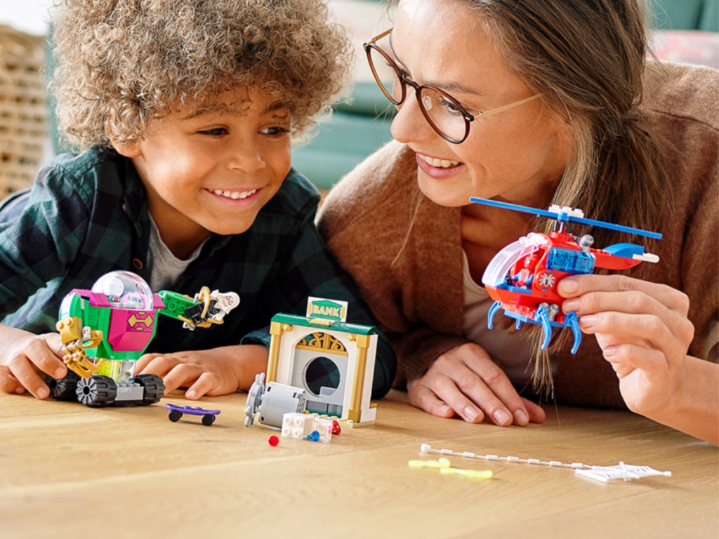 child and mother playing with a LEGO Marvel Spider-Man The Menace of Mysterio Superhero Building Set