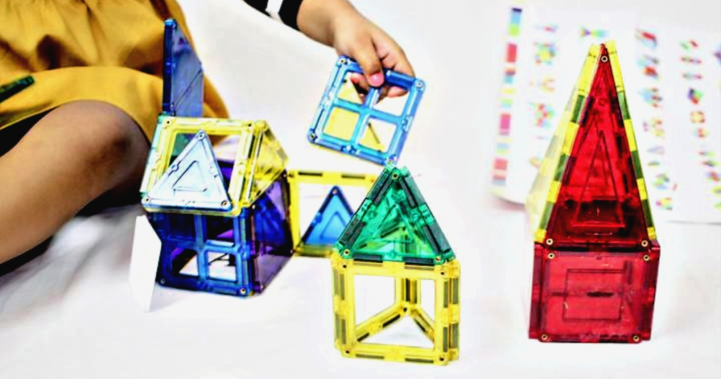 child playing with BCP Magnetic Building tiles