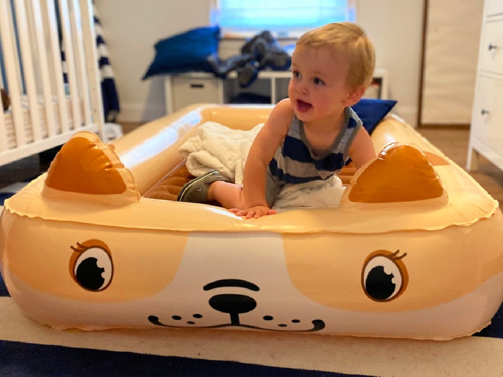 child sitting in a Sable Portable Kids Air Mattress with Electric Air Pump
