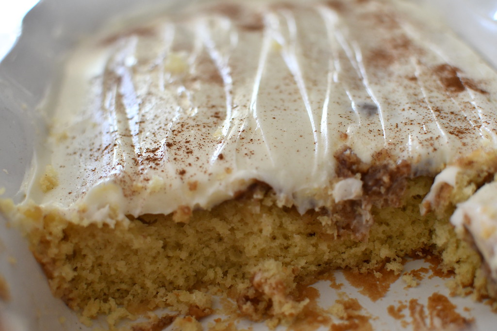 cinnamon roll poke cake in casserole dish