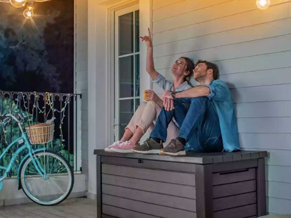 couple sitting on outdoor deck box