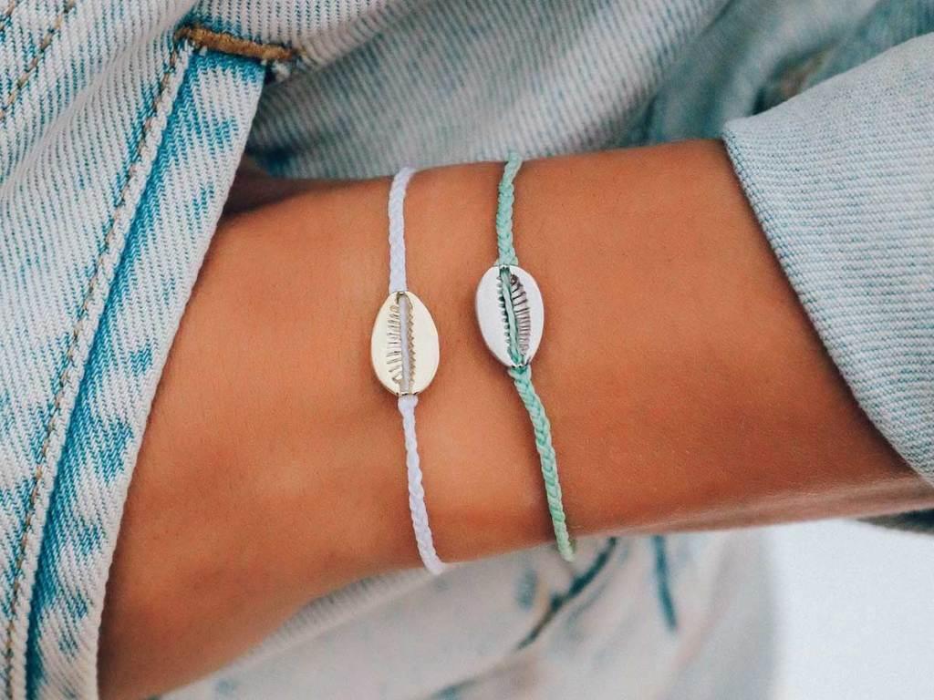 woman wearing two bracelets on her wrist
