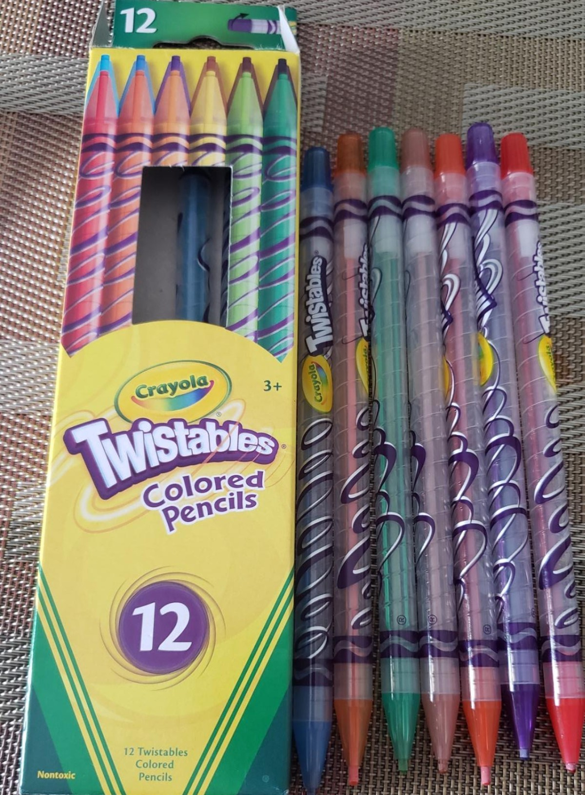Crayola Twistable colored pencils next to packaging