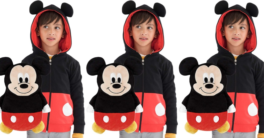 children wearing micky mouse colored jackets with stuffed animal