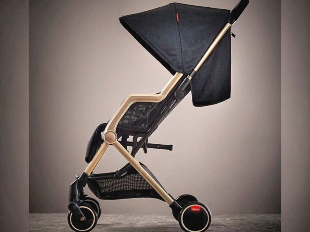 diono luxe stroller in gold and black