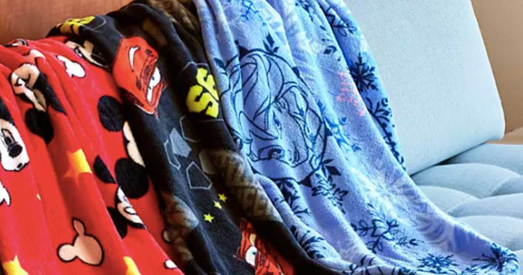 fleece blankets draped over a couch in fun prints