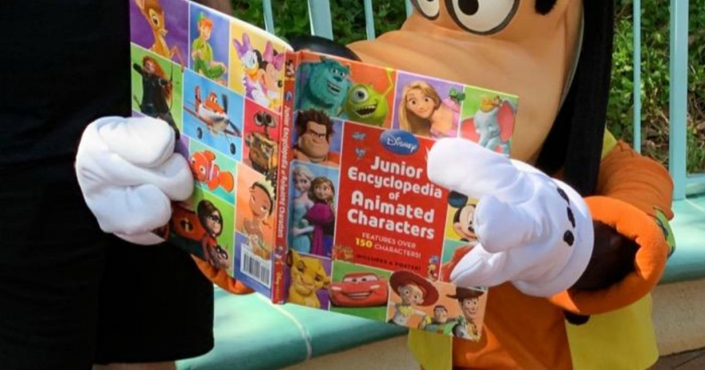 goofy holding a book of Disney characters
