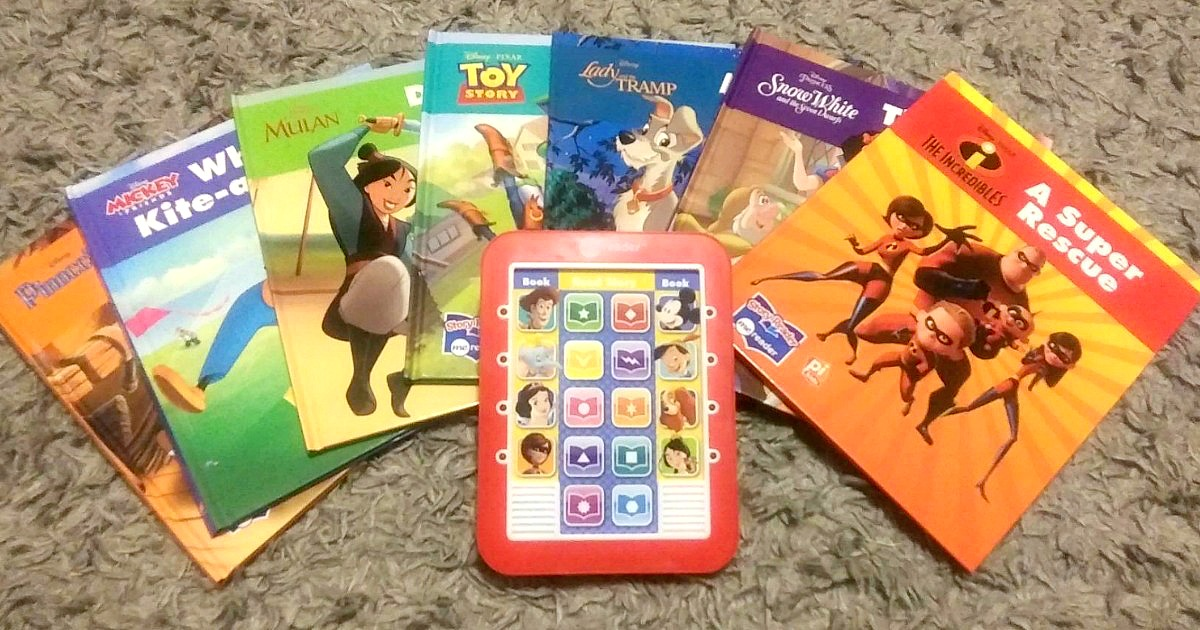 kids ereader with collection of Disney books on the floor
