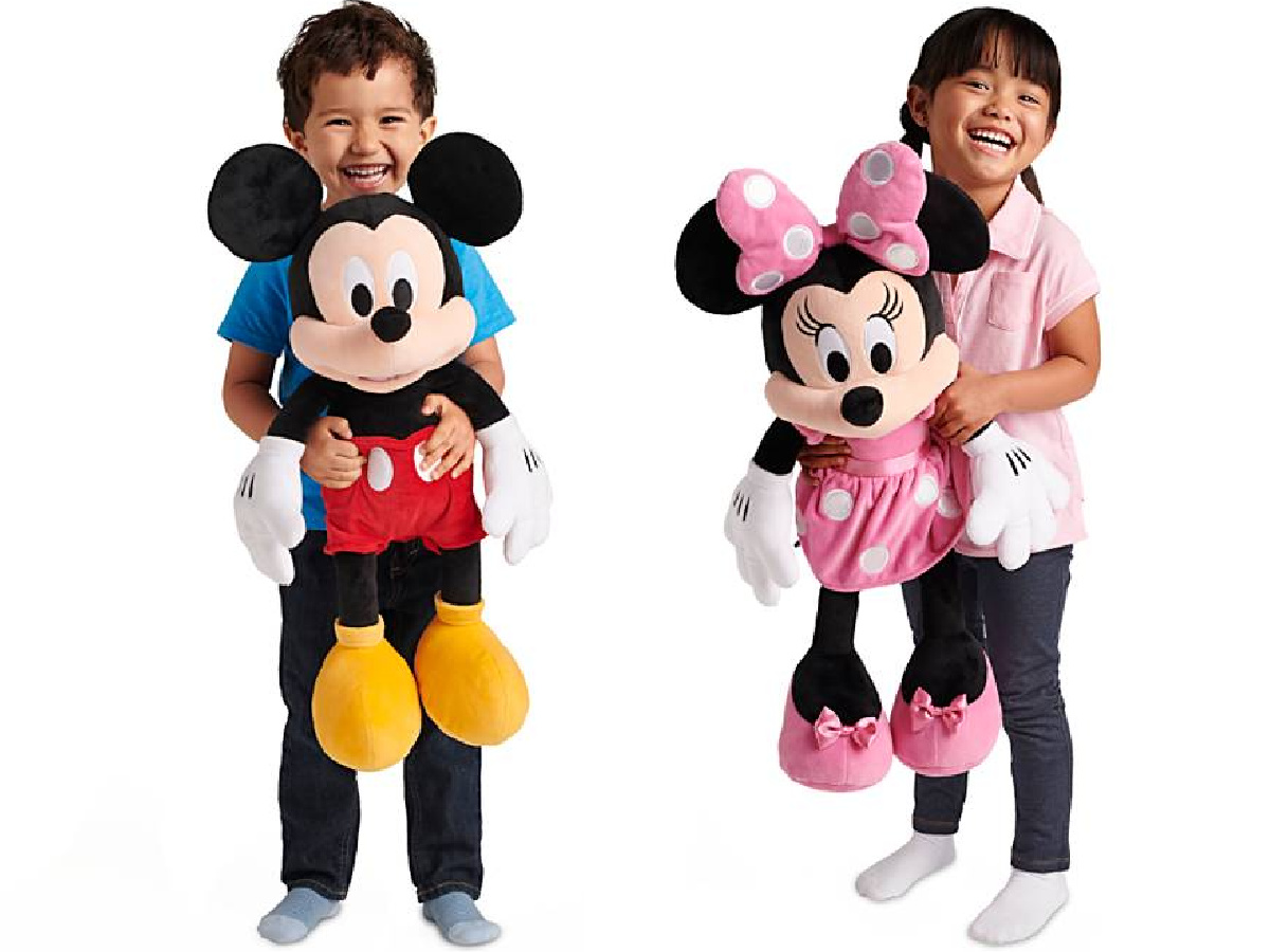 boy and girl holding mickey and minnie plush