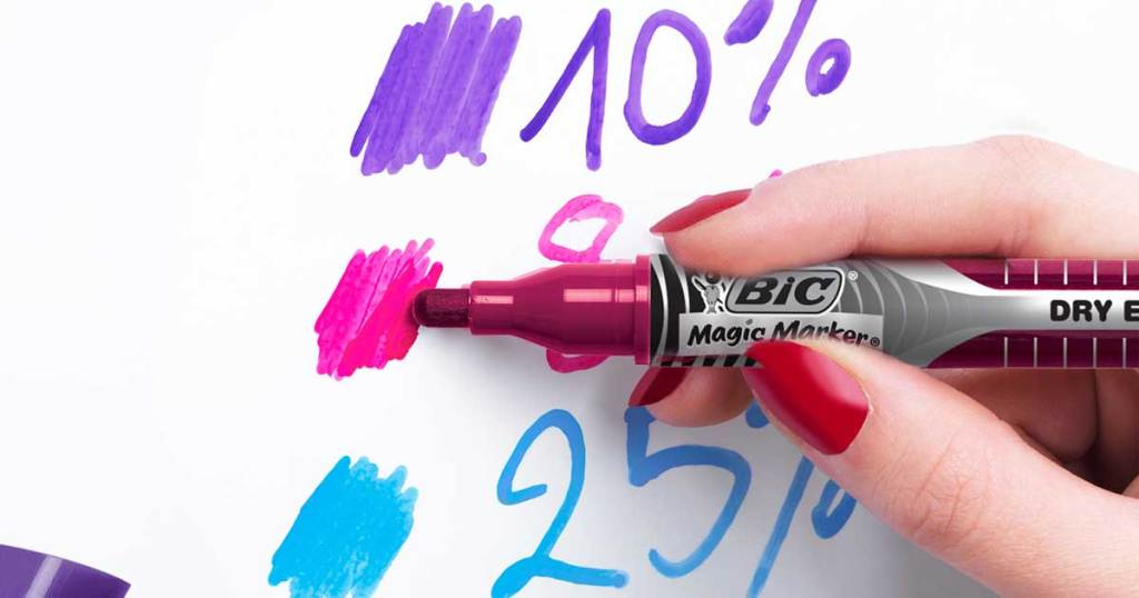 woman holding dry erase marker and writing numbers
