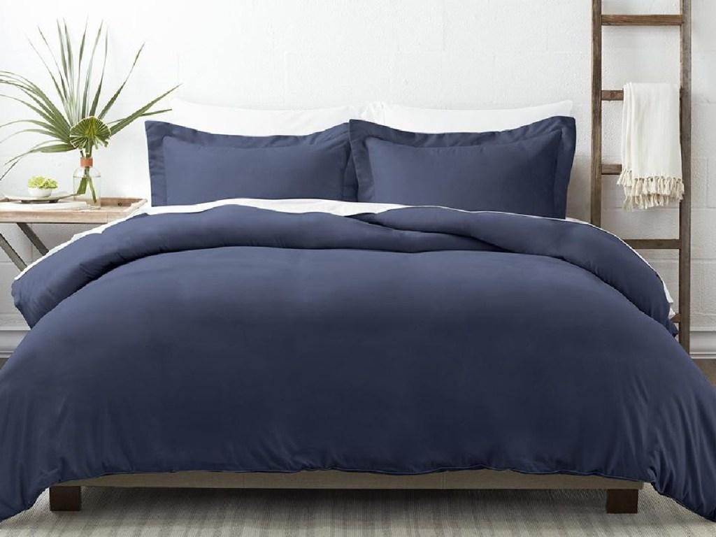 bedroom set with blue bedding