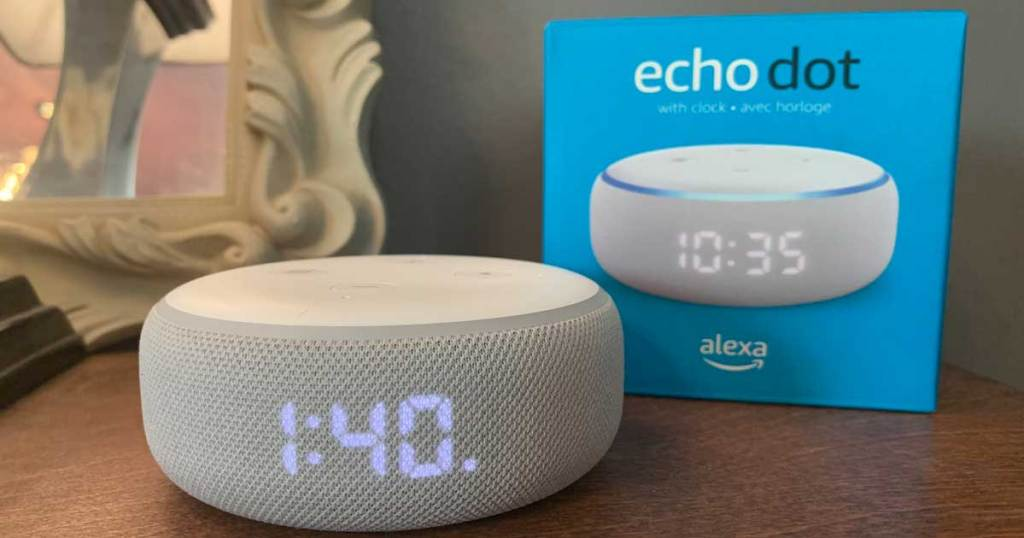 echo dot speaker in front of packaging on a night stand