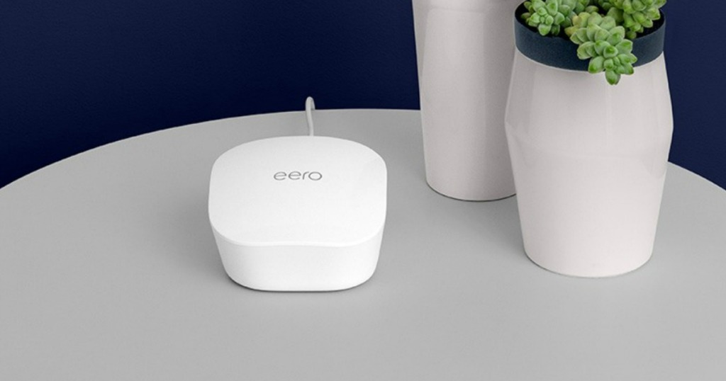 eero router on table by vases