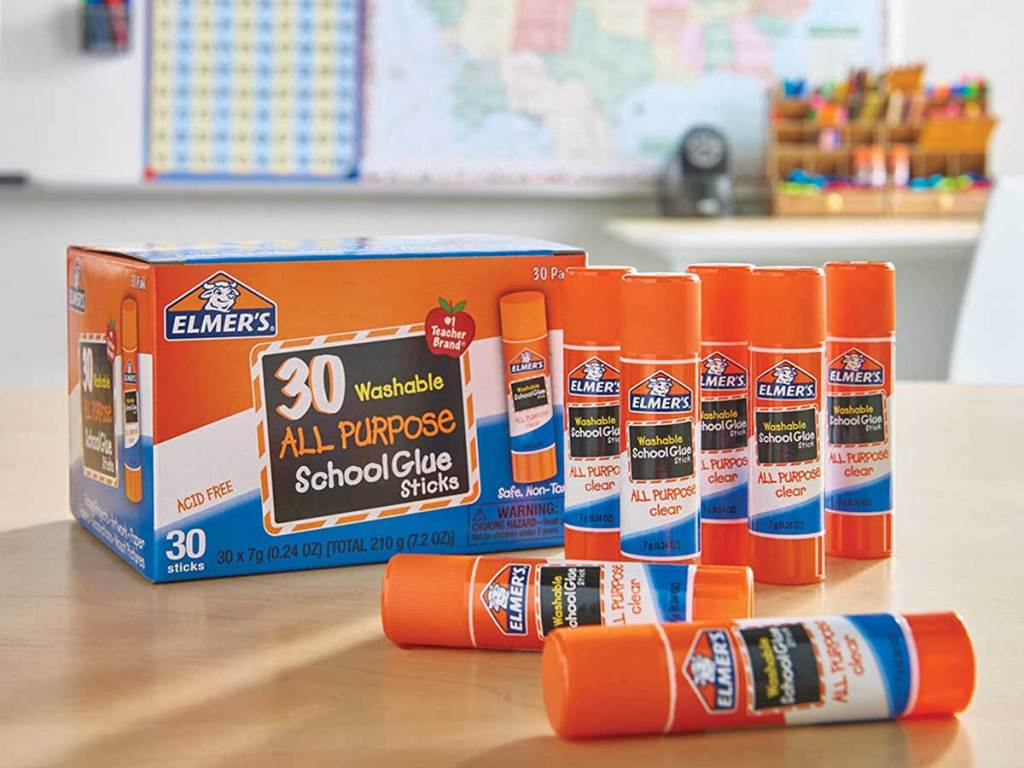 classroom with a box of 30 count glue sticks on a table