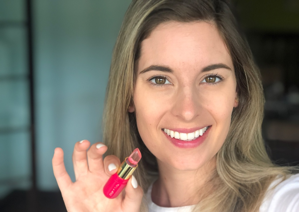 woman with winky lux lip balm and pink stain on lips