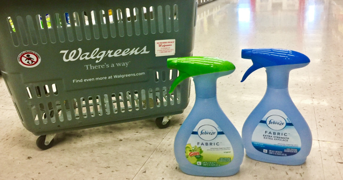 two bottles of Air freshener at walgreens on the floor in front of a walgreens basket