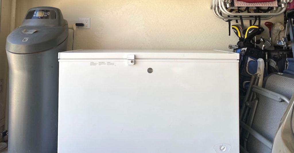white chest freezer sitting in garage