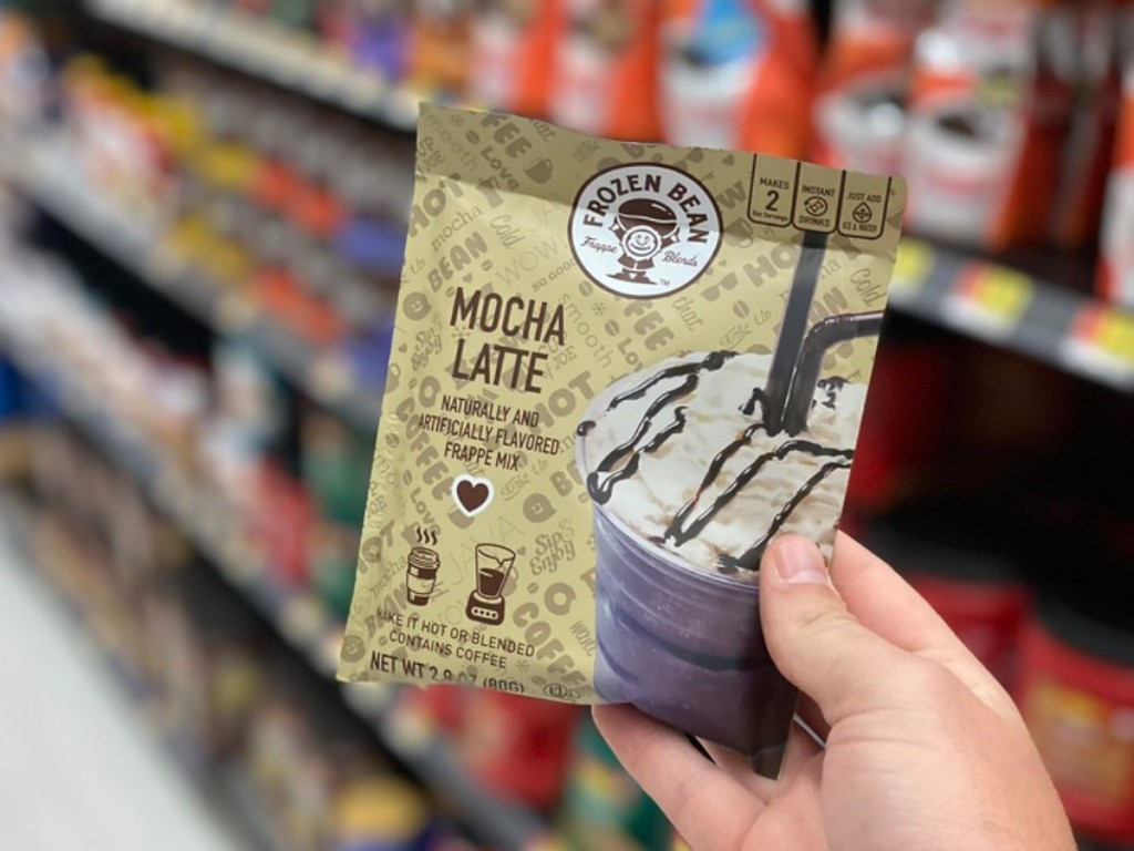 hand holding Mocha Latte pouch at store