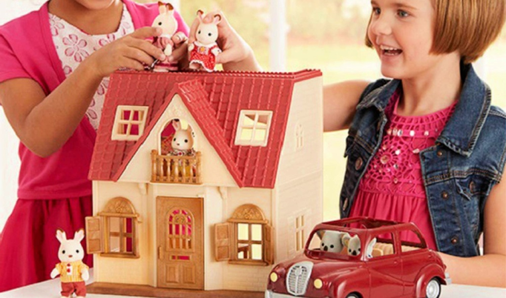 girls playing with Calico Critters Red Roof Cozy Cottage
