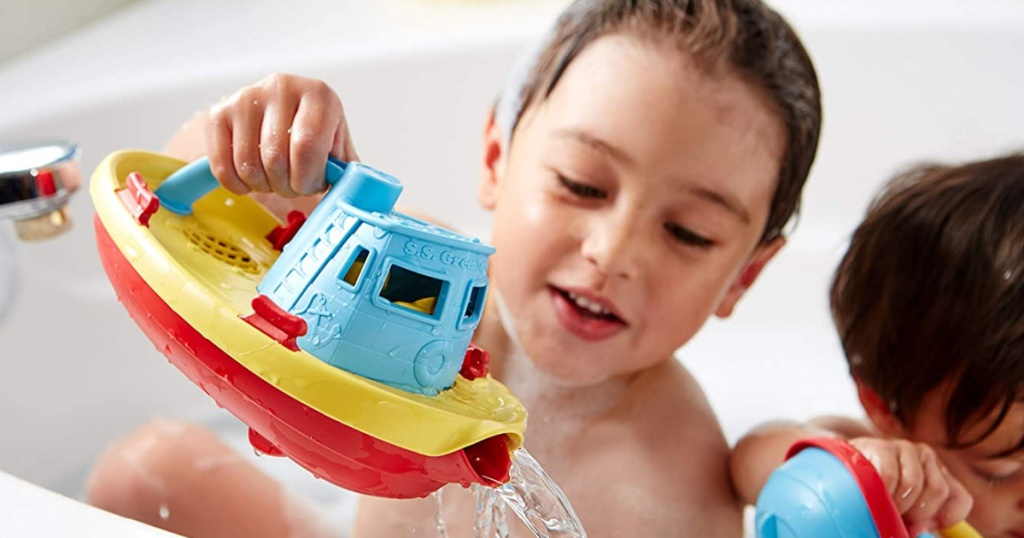 children in bubble bath playing with boats