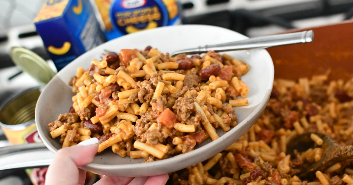 holding mac and cheese with taco meat