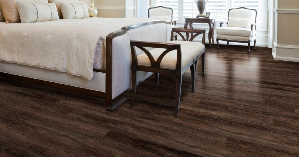 dark wood flooring in bedroom