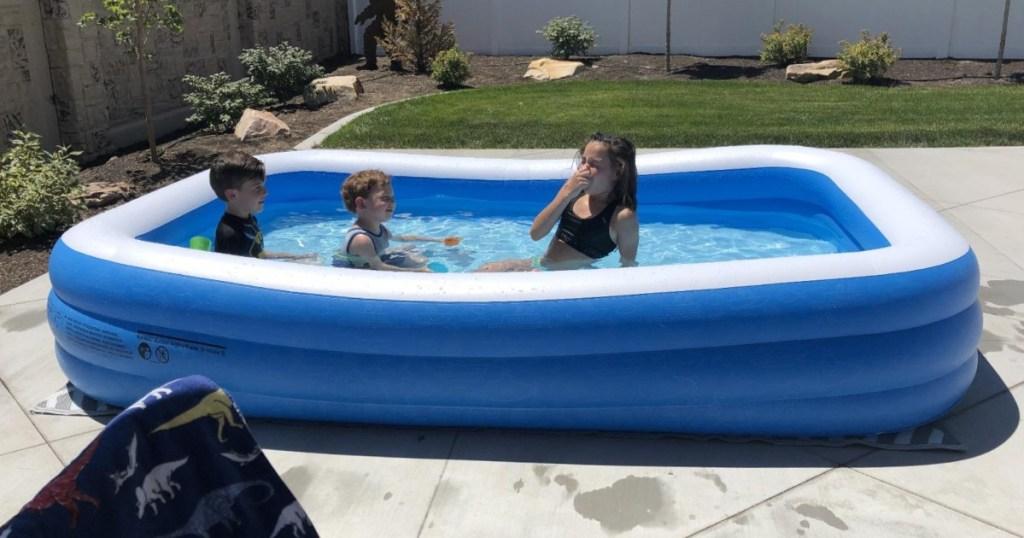 3 kids inside inflatable pool