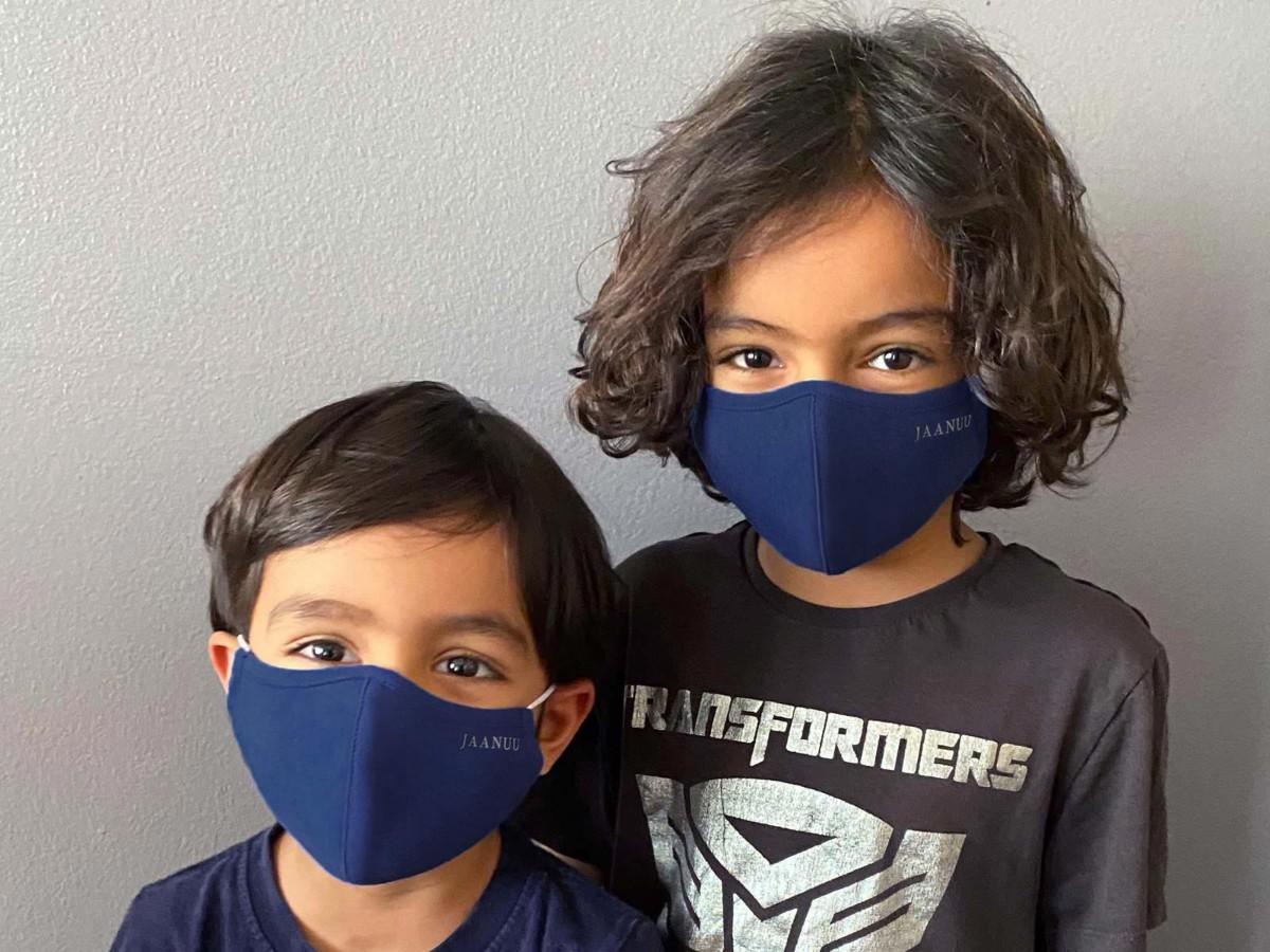 2 boys wearing blue face masks