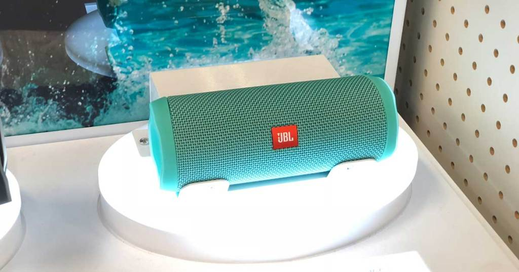 teal bluetooth speaker on display in a store