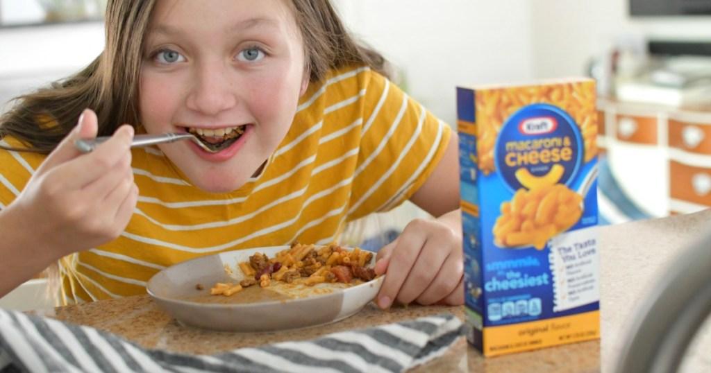 kid eating taco mac and cheese
