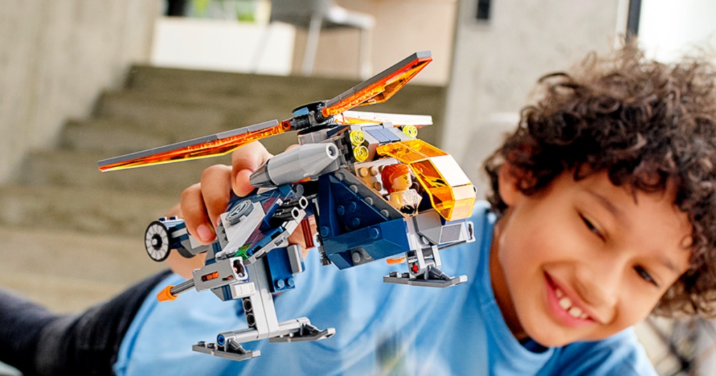 kid playing with a LEGO Super Heroes Avengers Hulk Helicopter Rescue set