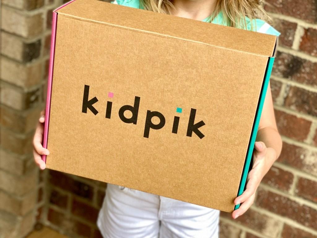 girl holding a kidpik box
