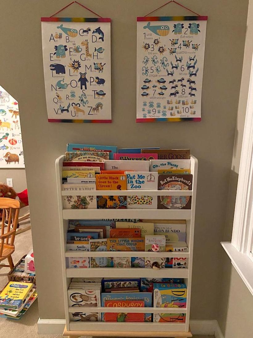 pictures handing above bookcase in kids playroom