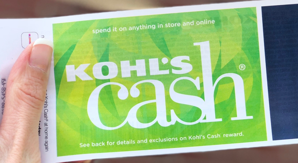 woman holding a kohl's cash certificate