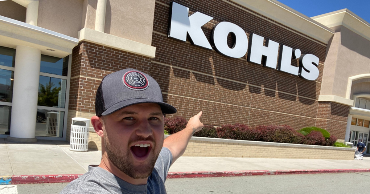 man pointing at Kohl's store
