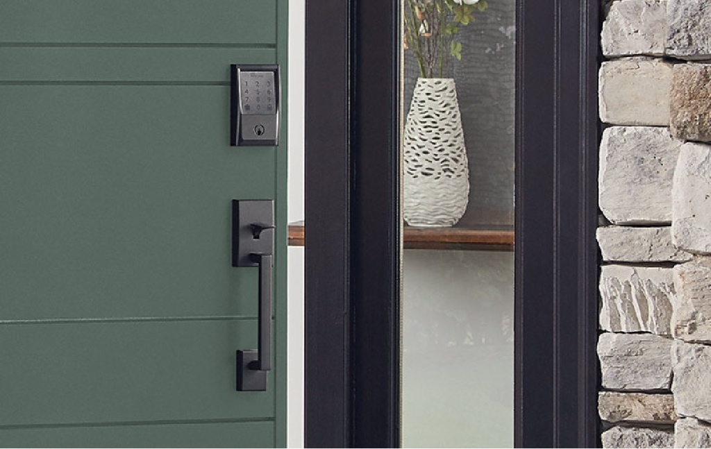 black smart lock on green door