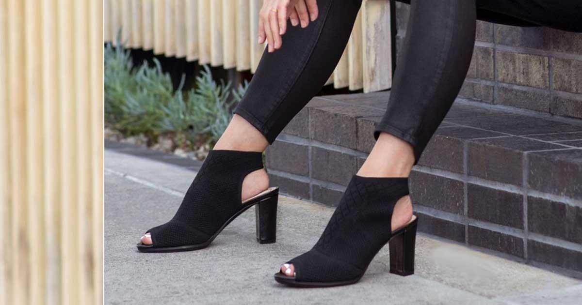 woman wearing black heel sandals outside