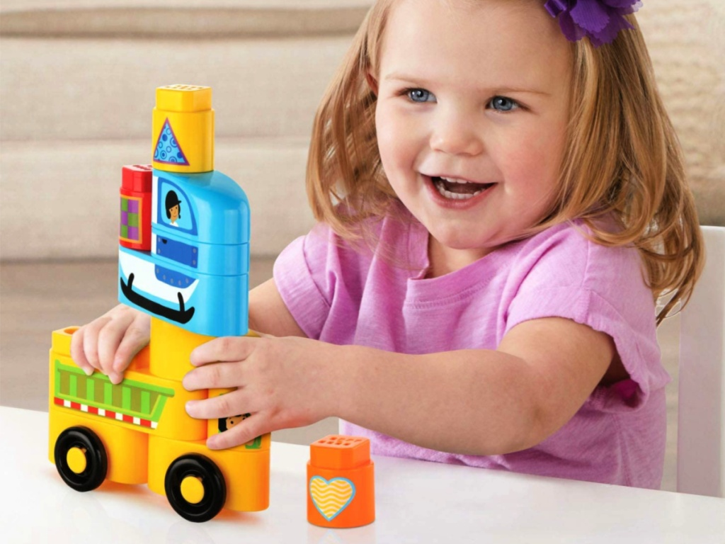 little girl playing with leapfrog toys