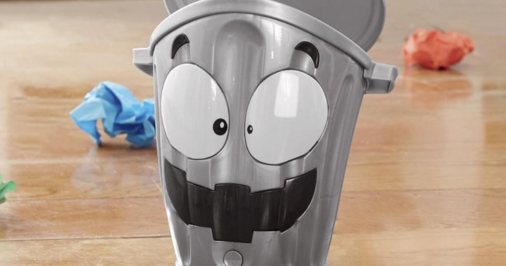 silver small trashcan with face painted on it