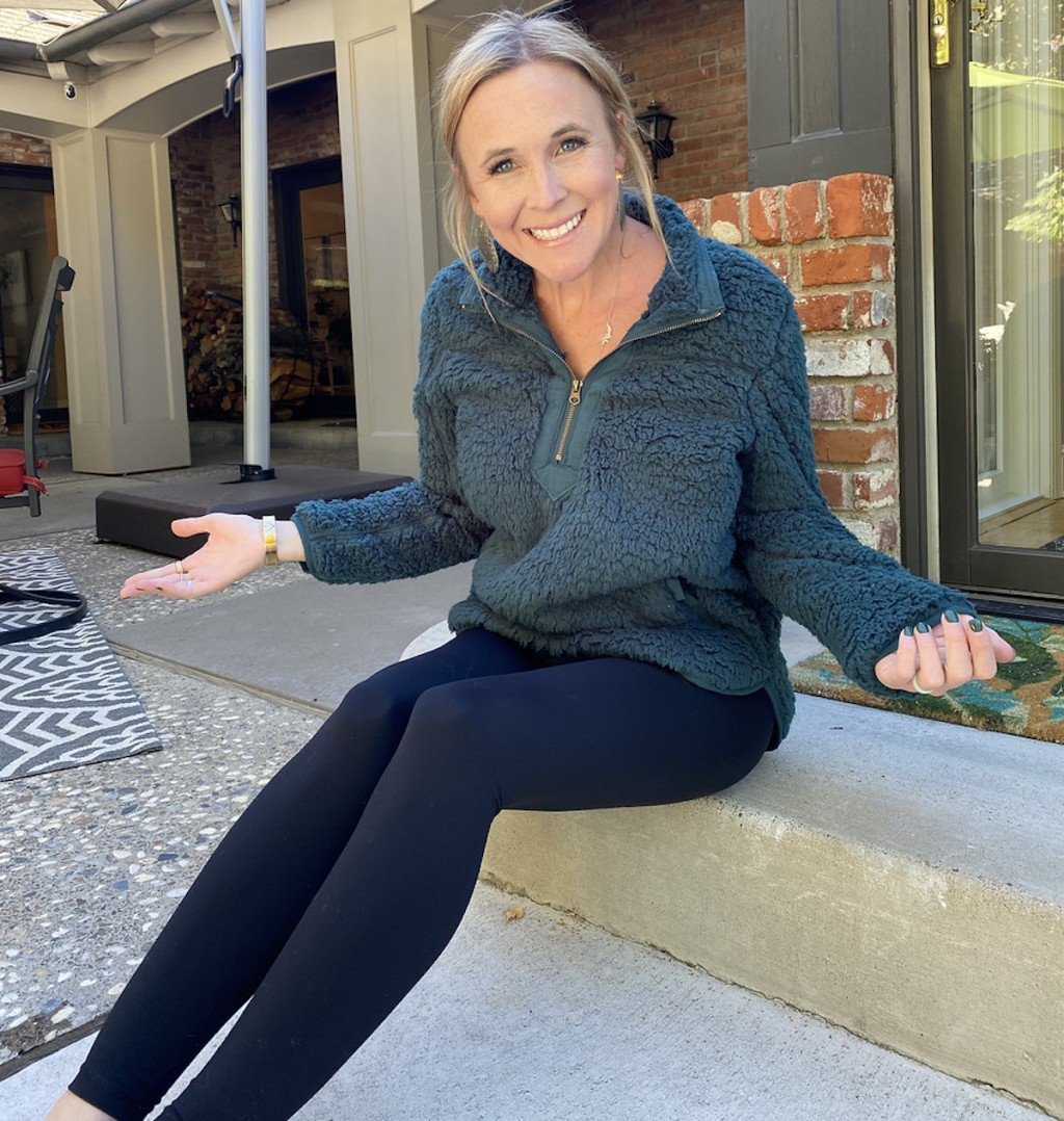 woman with arms out to side wearing lululemon dupes leggings and fuzzy sweater