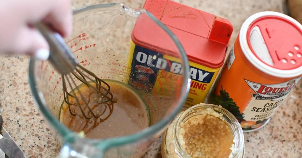 making a seasoned butter sauce for shrimp boil